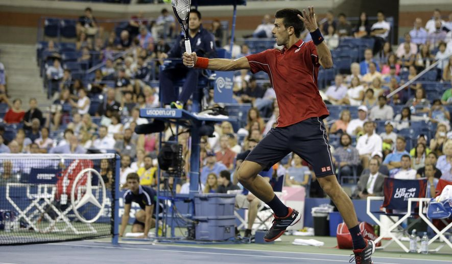 Novak Djokovic, of Serbia, returns a shot to Diego Schwartzman, of Argentina, during the opening round of the U.S. Open tennis tournament Monday, Aug. 25, 2014, in New York. (AP Photo/Darron Cummings)