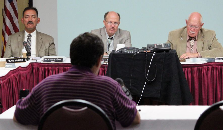 From left to right, Interstate Stream Commission Director Estevan Lopez, State Engineer Scott Verhines and Commission Chairman Jim Dunlap listen as Luna County Commissioner Javier Diaz testifies about the water needs of southwestern New Mexico during a commission meeting in Albuquerque, N.M., on Tuesday, Aug. 26, 2014. The commission has until the end of the year to decide what New Mexico will do with its share of the Gila River under the Arizona Water Settlement Act. (AP Photo/Susan Montoya Bryan)