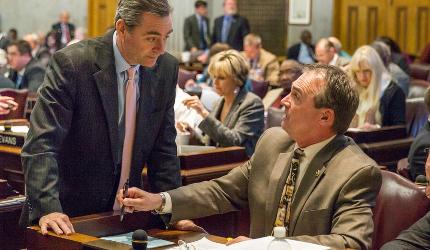 "FILE - In this April 15, 2014, file photo, Republican Reps. Rick Womick of Murfreesboro, seated right, and Glen Casada of Franklin confer on the House floor at the state Capitol in Nashville, Tenn. Womick on Tuesday, Aug. 26, 2014, called Republican Gov. Bill Haslam a ""traitor to the party"" over efforts by a political action committee defeat lawmakers who opposed the administration on Common Core education standards. (AP Photo/Erik Schelzig, file)"