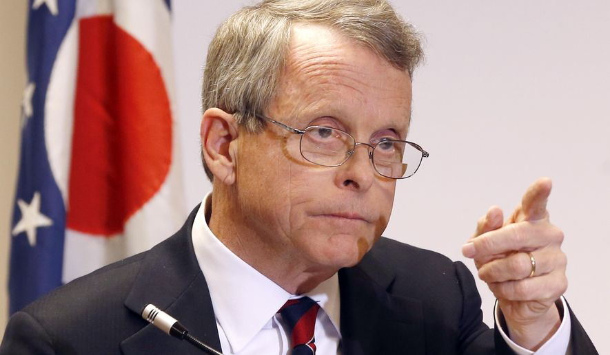 FILE - In this photo Monday, Nov. 25, 2013 photo, Ohio Attorney General Mike DeWine answers questions during a news conference in Steubenville, Ohio. DeWine's office says it required all employees to take a refresher sexual harassment course on the recommendation of a prosecutor who investigated a claim of harassment in the office two years ago. (AP Photo/Keith Srakocic, File)