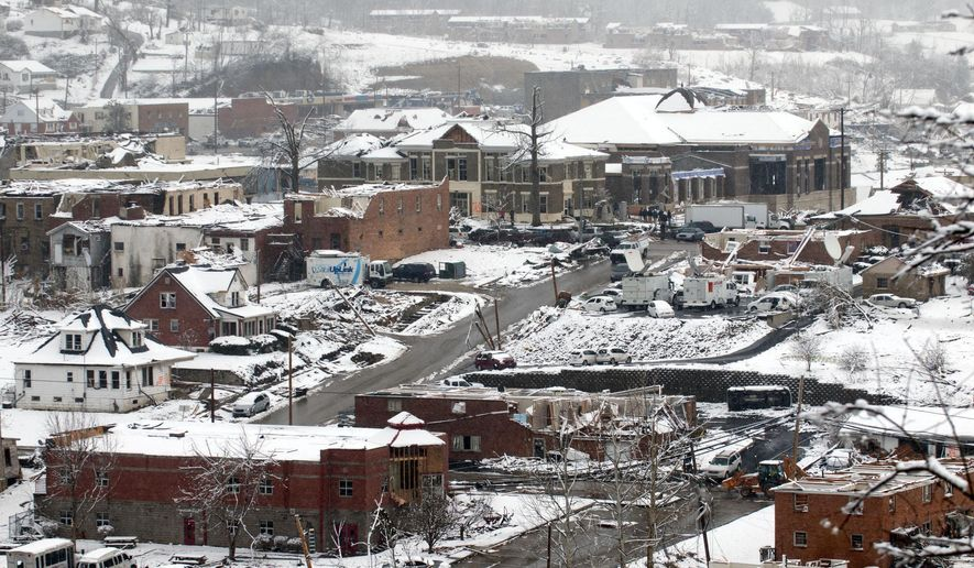 FILE - In this March 5, 2012, file photo, snow falls on West Liberty, Ky., as the town of 3,400 prepares to clean up from Friday's devastating tornado. Judge-Executive Tim Conley, who lead the reconstruction after the tornado, received $120,000 to $200,000 to steer work to a contractor in a scheme that started three years before the tornado and continued while the town struggled to rebuild, prosecutors said. Conley could spend years in prison. (AP Photo/John Flavell, File)