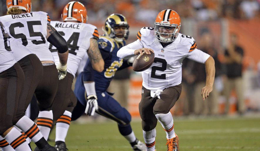 FILE - In this Aug. 23, 2014, file photo, Cleveland Browns quarterback Johnny Manziel (2) runs seven yards for a touchdown in the third quarter of a preseason NFL football game against the St. Louis Rams in Cleveland. Manziel doesn't view himself as the Browns' savior, but almost everyone else does. The dynamic rookie quarterback will begin the season as Cleveland's second-string quarterback, but it may not be long before he's moved ahead of Brian Hoyer, who already seems to be looking over his shoulder. (AP Photo/David Richard, File)