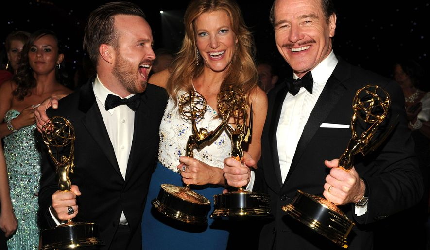 IMAGE DISTRIBUTED FOR THE TELEVISION ACADEMY - EXCLUSIVE - Aaron Paul, from left, Anna Gunn and Bryan Cranston attend the Governors Ball at the 66th Primetime Emmy Awards at the Nokia Theatre L.A. Live on Monday, Aug. 25, 2014, in Los Angeles. (Photo by Frank Micelotta/Invision for the Television Academy/AP Images)