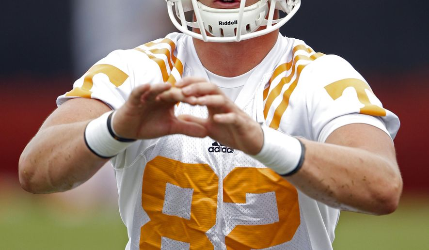 In this Aug. 2, 2014, photo, Tennessee tight end Ethan Wolf catches the ball during practice in Knoxville, Tenn.  The youth of Tennessee's roster will be apparent as soon as the Volunteers take the field Sunday for their season opener against Utah State. Tennessee has at least three true freshmen in starting roles. (AP Photo, Knoxville News Sentinel, Wade Payne)