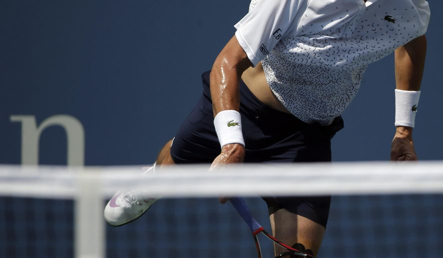 John Isner, of the United States, serves against Marcos Giron, of the United States, during the opening round of the 2014 U.S. Open tennis tournament, Tuesday, Aug. 26, 2014, in New York. (AP Photo/Kathy Willens)