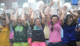 "COLD FOR A CAUSE: Incoming freshmen (from left) Natalya Stefanovich, Victoria Good, Caitlyn Spetzer, Crystal Cosgrove and Nicole Dunn at Mount Aloysius College in Pennsylvania take the ALS ice bucket challenge. Even politicians and celebrities are getting in on the act with everyone from former President George W. Bush, actress Lindsay Lohan and former presidential candidate Mitt Romney all willingly getting doused with freezing water for the cause. In this image from video posted on Facebook, courtesy of the George W. Bush Presidential Center, former President George W. Bush participates in the ice bucket challenge with the help of his wife, Laura Bush, in Kennebunkport, Maine. The challenge has caught on with notable figures participating in the campaign to raise money for the fight against ALS, or Lou Gehrig's disease. The phenomenal success of the fundraising craze is making charitable organizations rethink how they connect with a younger generation of potential donors, specifically through social media. (AP Photo/Courtesy George W. Bush Presidential Center) This Aug. 20, 2014 photo released by NBC shows host Jimmy Fallon, left, dumping a bucket of ice water over the head of actress Lindsay Lohan as she participates in the ALS Ice Bucket Challenge on ""The Tonight Show Starring Jimmy Fallon,"" in New York. The phenomenal success of the fundraising craze is making charitable organizations rethink how they connect with a younger generation of potential donors, specifically through social media. (AP Photo/NBC, Douglas Gorenstein) Former presidential candidate Mitt Romney took the ALS Ice Bucket challenge in a video posted to his Facebook Page. Congressman Paul Ryan (R-Wisc.), dumped the bucket of water on his former running mate. (THE MORNING CALL OUT via Associated Press)"