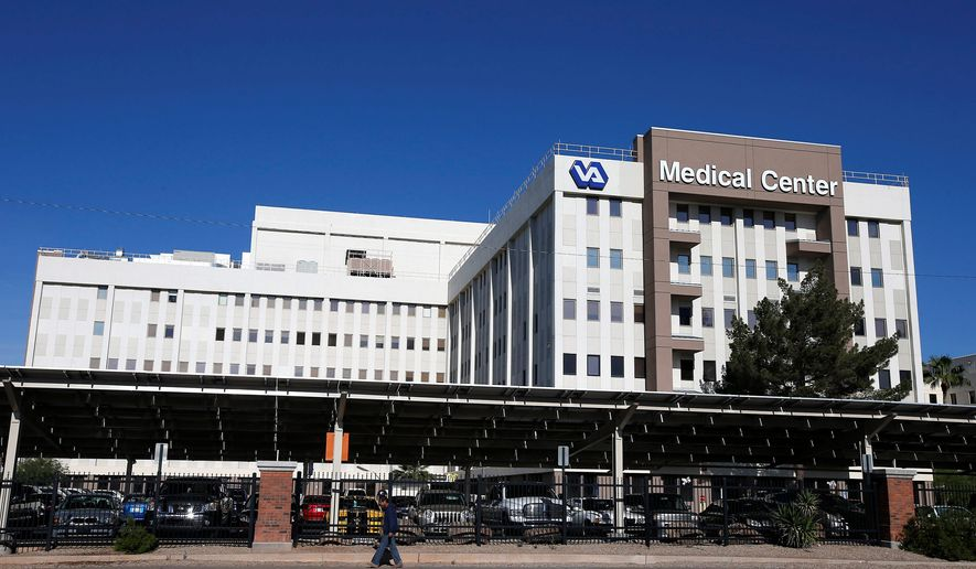 FILE - This photo taken April 28, 2014 shows the Phoenix VA Health Care Center in Phoenix. The Department of Veterans Affairs says investigators have found no proof that delays in care caused any deaths at a VA hospital in Phoenix, deflating an explosive allegation that helped expose a troubled health care system in which veterans waited months for appointments while employees falsified records to cover up the delays. (AP Photo/Ross D. Franklin, File)