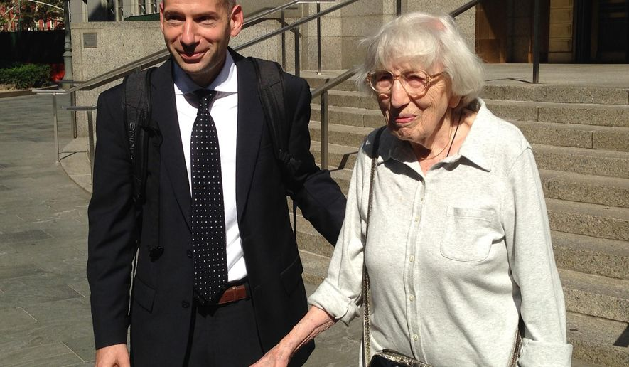 Miriam Moskowitz leaves federal court with her lawyer Guy Eddon, Monday Aug. 25, 2014 in New York after trying to clear her name after she was convicted in 1950 of conspiracy in the run-up to the atomic spying trial of Julius and Ethel Rosenberg. Moskowitz, 98, of New Jersey, said after a brief court hearing that she needs an official vindication that she was wrongly convicted when she was sentenced to two years in prison. She filed the request two weeks ago, saying documents now prove the government withheld evidence that would have exonerated her. (AP Photo/Lawrence Neumeister)