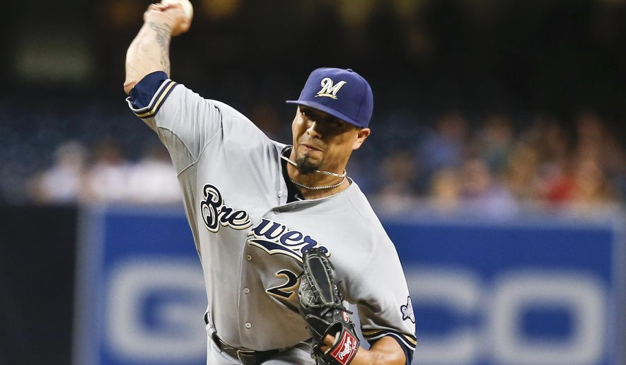 Milwaukee Brewers starting pitcher Kyle Lohse works against the San Diego Padres in the first inning of a baseball game Monday, Aug. 25, 2014, in San Diego.  (AP Photo/Lenny Ignelzi)