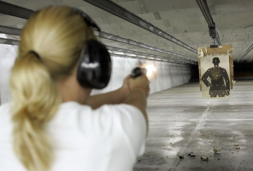 Jennifer Deasy shoots a pistol at the target range at Niagara Gun Range in North Tonawanda, N.Y., Thursday June 26, 2008. Americans can keep guns at home for self-defense, the Supreme Court ruled Thursday in the justices' first-ever pronouncement on the meaning of gun rights under the Second Amendment. (AP Photo/David Duprey)
