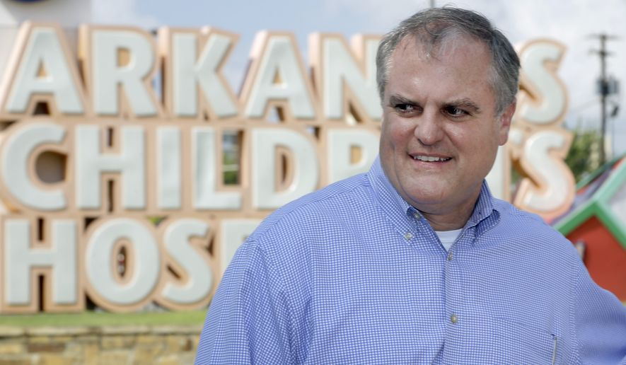 U.S. Sen. Mark Pryor, D-Ark., walks near near an entrance to Arkansas Children's Hospital in Little Rock, Ark., after a news conference Tuesday, Aug. 26, 2014. Pryor faces a challenge from Republican Congressman Tom Cotton in the November election. (AP Photo/Danny Johnston)