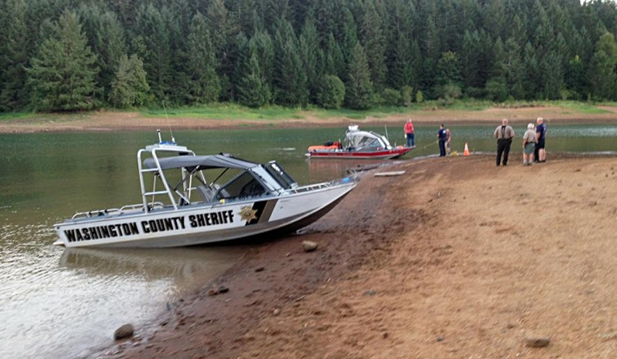 """This photo provided by the Washington County, Ore., Sheriff's Office shows a search underway Tuesday, Aug. 26, 2014, for family members of a child who apparently drowned Monday at Henry Hagg Lake, a reservoir in Gaston, Ore., west of Portland. """"Deputies fear there may be additional drowning victims,"""" the sheriff's office said in a press release. (AP Photo/Washington County Sheriff)"""