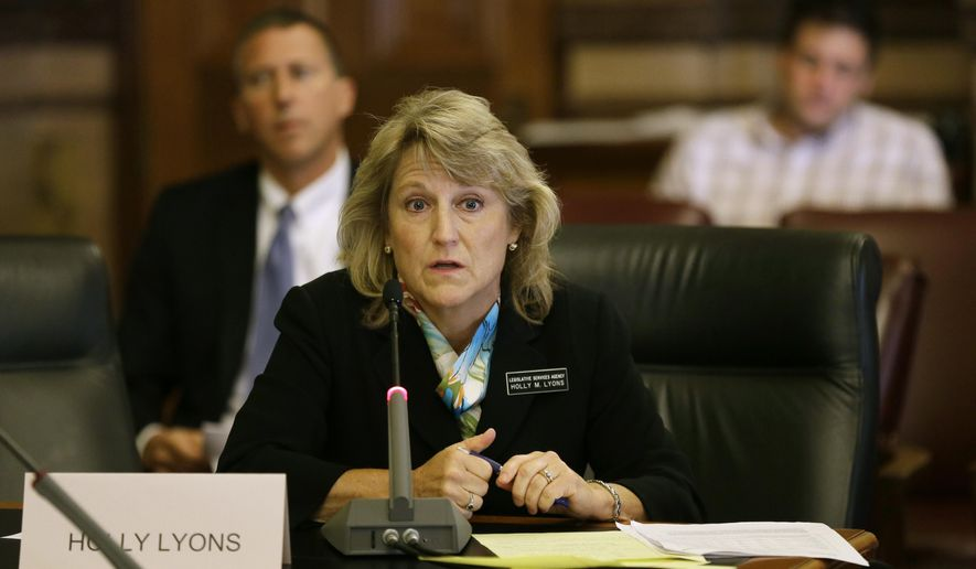 Iowa Fiscal Services Division Director Holly Lyons speaks during the Iowa Senate Government Oversight Committee meeting, Tuesday, Aug. 26, 2014, at the Statehouse in Des Moines, Iowa. The Senate Government Oversight Committee is calling judges who decide Iowa unemployment cases to testify in an investigation into alleged abuse of power at Iowa Workforce Development. (AP Photo/Charlie Neibergall)