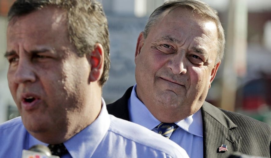 "FILE - In this May 7, 2014 file photo, Maine Gov. Paul LePage, right, listens as New Jersey Gov. Chris Christie speaks outside Becky's Diner in Portland, Maine. Instead of downplaying LePage's blunt-speaking candor, new television ads from the Republican Governors Association are touting him as as ""blunt, honest, one-of-a-kind"" as he campaigns for reelection on Nov. 4. Christie, who heads the RGA, has twice visited Maine to help LePage in his reelection bid.(AP Photo/Robert F. Bukaty)"