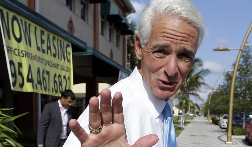 Former Florida Gov. Charlie Crist waves after  visiting a phone bank, Monday, Aug. 25, 2014,  in Fort Lauderdale,  Fla. Crist is running against opponent Nan Rich for the democratic nomination for Florida Governor. Florida's primary election is Tuesday. (AP Photo/Lynne Sladky)