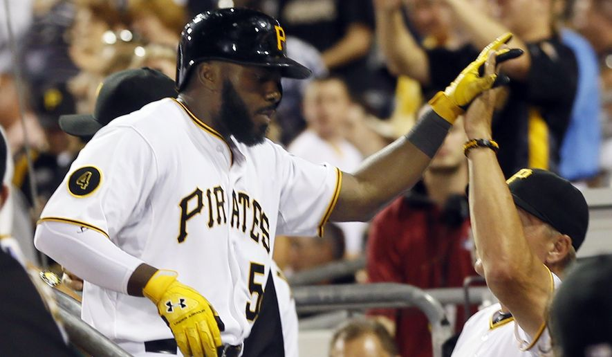 Pittsburgh Pirates' Josh Harrison (5) is greeted in the dugout by bench coach Jeff Banister after hitting a solo home run in the fifth inning of the baseball game against the St. Louis Cardinalson Tuesday, Aug. 26, 2014, in Pittsburgh. (AP Photo/Keith Srakocic)