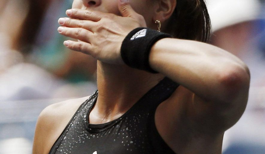 Ana Ivanovic, of Serbia, blows a kiss to the crowd after defeating Alison Riske, of the United States, during the opening round of the 2014 U.S. Open tennis tournament, Tuesday, Aug. 26, 2014, in New York. (AP Photo/Kathy Willens)