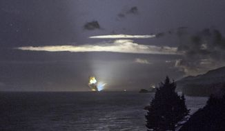 This Monday, Aug. 25, 2014, photo provided by Scott Wight shows the horizon from Cape Greville in Chiniak, Alaska, after a rocket carrying an experimental Army strike weapon exploded after taking off from a launch pad in Alaska. (AP Photo/Scott Wight) ** FILE **
