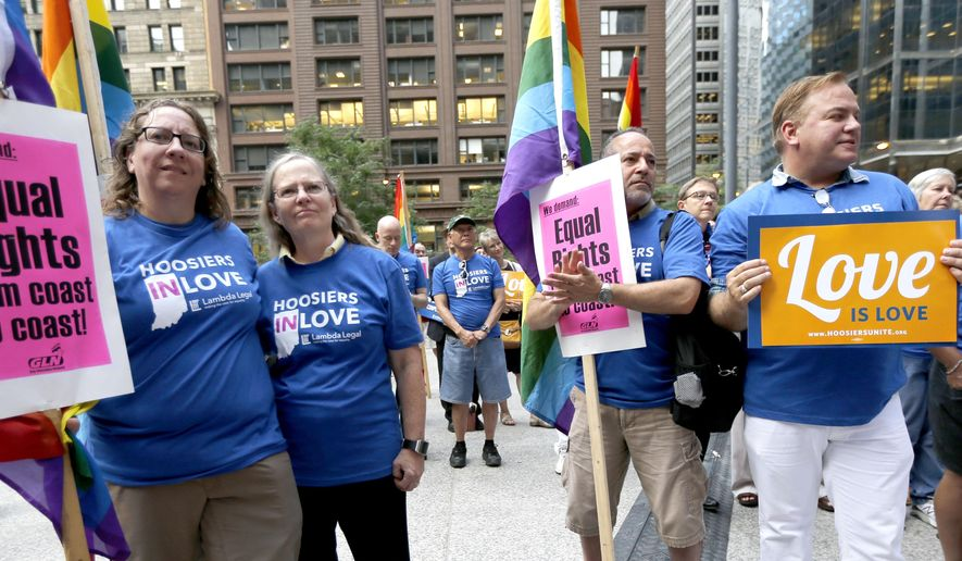 Supporters of gay marriage in Wisconsin and Indiana attend a rally at the federal plaza Monday, Aug. 25, 2014, in Chicago. The Chicago-based 7th U.S. Circuit Court of Appeals will hear arguments Tuesday on gay marriage fights from Indiana and Wisconsin, setting the stage for one ruling. Each case deals with whether statewide gay marriage bans violate the Constitution. (AP Photo/Charles Rex Arbogast)