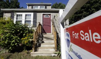 FILE - In this Wednesday, Sept. 18, 2013 file photo a for sale sign hangs in front of a house in Walpole, Mass.  Freddie Mac reports on mortgage rates for this week Thursday April 14, 2014.  (AP Photo/Steven Senne, File)