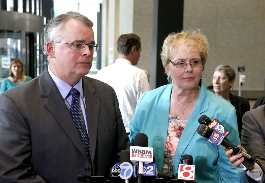 Julaine Appling, president of Wisconsin Family Action, right, and her organization's attorney Mike Dean, defenders of Wisconsin's state ban on gay marriage, talk to reporters after attending a hearing before the 7th U.S. Circuit Court of Appeals on the challenges to Indiana and Wisconsin's gay marriage ban Tuesday, Aug. 26, 2014, in Chicago. (AP Photo/Charles Rex Arbogast)