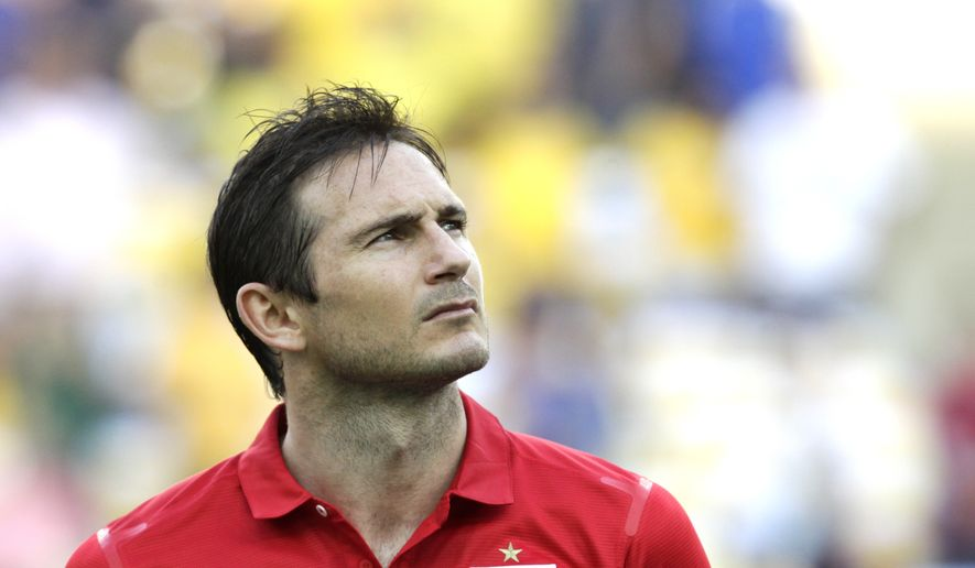 FILE - In this Sunday, June 2, 2013 file photo, England's Frank Lampard stands during the playing of the British national anthem before the start of an international soccer friendly against Brazil at the Maracana stadium in Rio de Janeiro, Brazil. Frank Lampard has retired from England's national team ahead of qualifying for the 2016 European Championship, it was reported on Tuesday, Aug. 26, 2014. Since making his England debut in 1999, the 36-year-old Lampard has scored 29 goals in 106 appearances, with his last appearance coming at the World Cup in June. (AP Photo/Victor R. Caivano, File)