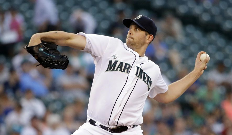 Seattle Mariners starting pitcher James Paxton throws against the Texas Rangers in the second inning of a baseball game Tuesday, Aug. 26, 2014, in Seattle. (AP Photo/Elaine Thompson)