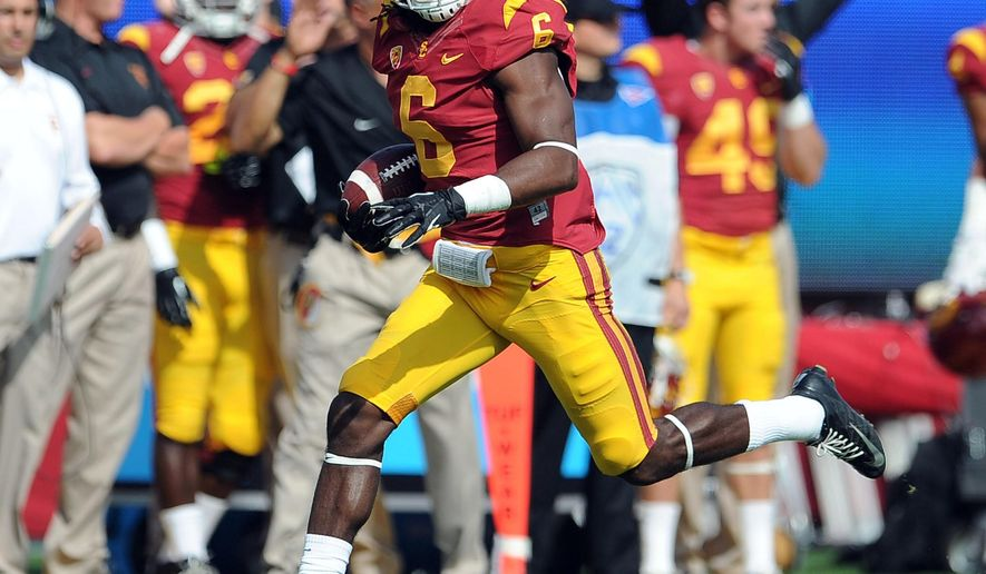 "FILE - In this Oct. 26, 2013, file photo, Southern California safety Josh Shaw recovers a Utah fumble in an NCAA college football game in Los Angeles. Shaw confessed that he lied to school officials about how he sprained his ankles last weekend, retracting his story about jumping off a balcony to save his drowning nephew. The school swiftly suspended him from all football team activities Wednesday, Aug. 27, 2014, and acknowledged his heroic tale was ""a complete fabrication."" (AP Photo/Pasadena Star-News, Keith Birmingham, File) NO SALES"