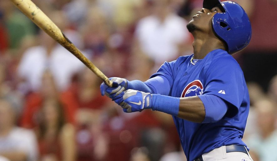 Chicago Cubs' Jorge Soler hits a pop fly for an out in the fourth inning of a baseball game against the Cincinnati Reds, Wednesday, Aug. 27, 2014, in Cincinnati. Soler was making his major league debut. (AP Photo/Al Behrman)