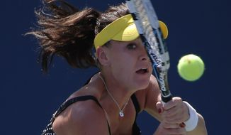 Agnieszka Radwanska, of Poland, returns a shot against Shuai Peng, of China, during the second round of the 2014 U.S. Open tennis tournament, Wednesday, Aug. 27, 2014, in New York. (AP Photo/Elise Amendola)
