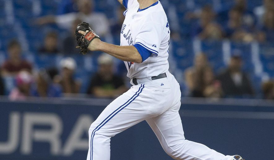 Toronto Blue Jays infielder Steve Tolleson pitches against Boston Red Sox during the 11th inning of a baseball game Tuesday, Aug. 26, 2014, in Toronto. Boston won 11-7. (AP Photo/The Canadian Press, Chris Young)