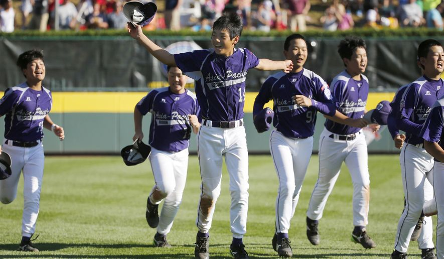 South Korea's Tae Min Moon (14) leads his teammates in a victory lap around Howard J. Lamade Stadium after winning 8-4 over Chicago in the Little League World Series championship baseball game in South Williamsport, Pa., Sunday, Aug. 24, 2014. (AP Photo/Gene J. Puskar)