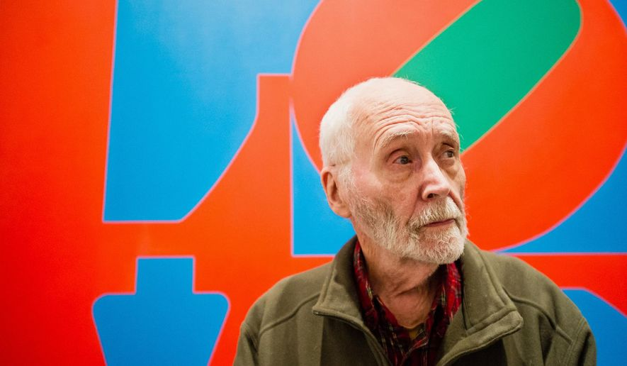 FILE - In this Sept. 24, 2013, file photo, artist Robert Indiana, known world over for his LOVE image, is interviewed in front of that painting at New York's Whitney Museum of American Art. The Maine-based pop artist plans to participate in International HOPE Day, a celebration of his art in countries across the world. Indiana will make a public appearance at noon outside his residence and studio on Vinalhaven Island on Sept. 13.(AP Photo/Lauren Casselberry, File)