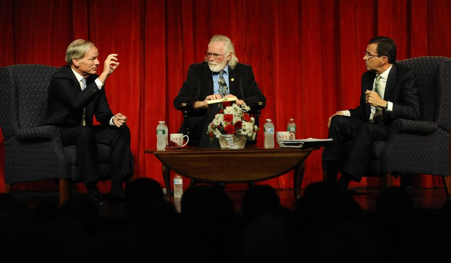 Republican candidate for governor Tom Foley, left, speaks to Democratic candidate Dannel P. Malloy, right, as moderator Ray Hackett of the Norwich Bulletin, center, looks on, during a debate, Wednesday, Aug. 27, 2014, in Norwich, Conn.  (AP Photo/Jessica Hill)