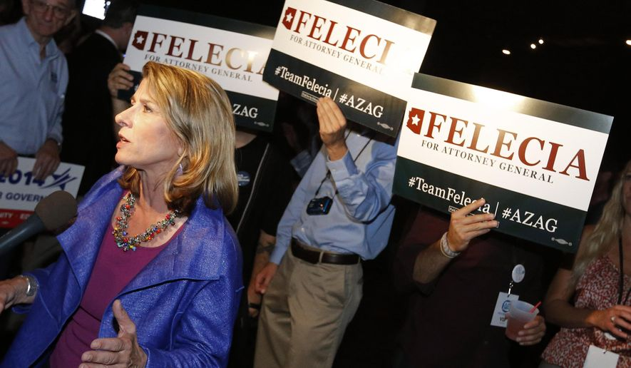 Arizona Democratic Attorney General candidate Felecia Rotellini speaks, Tuesday, Aug. 26, 2014, at a primary election party in Phoenix. (AP Photo/Matt York)