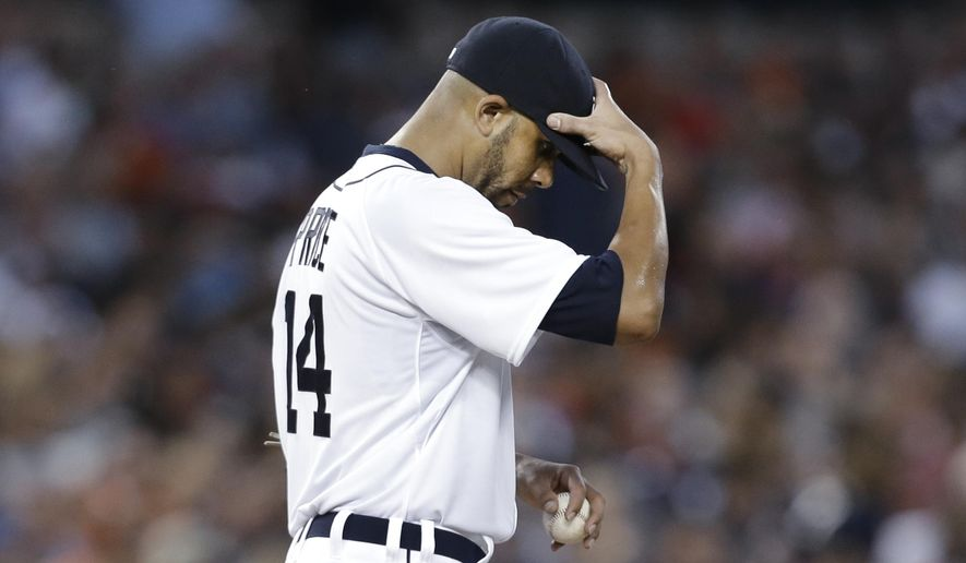 Detroit Tigers pitcher David Price reacts in the third inning of a baseball game against the New York Yankees in Detroit, Wednesday, Aug. 27, 2014. Price allowed eight earned runs in two innings. (AP Photo/Paul Sancya)