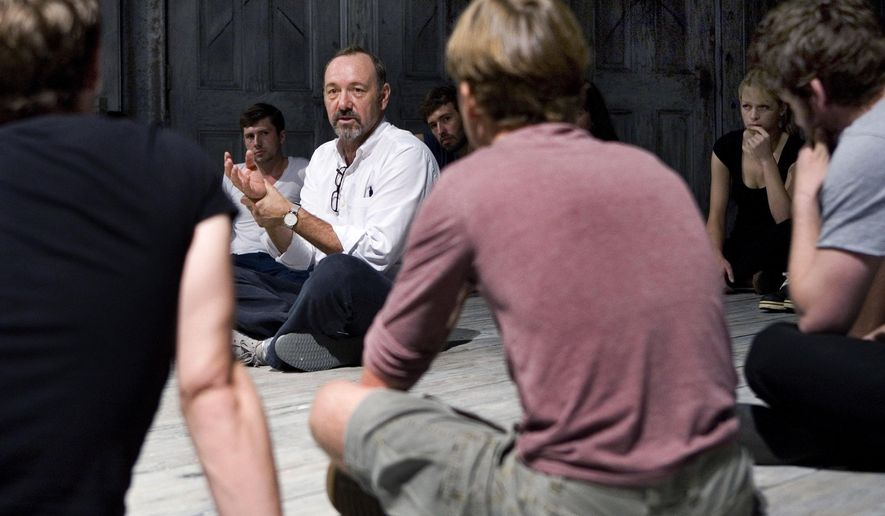 In this 2011 photo provided by The Kevin Spacey Foundation, actor Kevin Spacey teaches 20 actors at The Old Vic, on the stage set of Richard III, in London. The actors were selected by Steve Winter, program director for The Kevin Spacey Foundation, as part of a talent search called Richard's Rampage. Spacey will show off his vocal talents at a one-night-only gala concert Sept. 29, 2014, at the Shakespeare Theatre in Washington. The concert will benefit scholarships and grants for emerging artists. (AP Photo/The Kevin Spacey Foundation, Lucy Cullen)