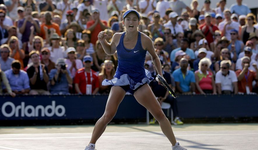 Catherine Bellis, of the United States, reacts after a point against Dominika Cibulkova, of Slovakia, during the first round of the 2014 U.S. Open tennis tournament, Tuesday, Aug. 26, 2014, in New York. (AP Photo/Darron Cummings)