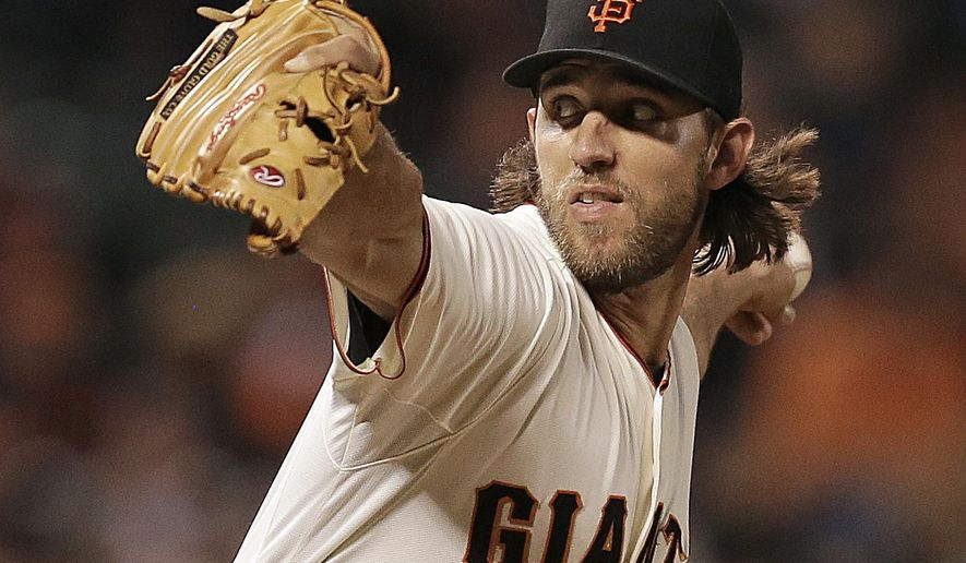 San Francisco Giants' Madison Bumgarner works against the Colorado Rockies in the seventh inning of a baseball game Tuesday, Aug. 26, 2014, in San Francisco. (AP Photo/Ben Margot)