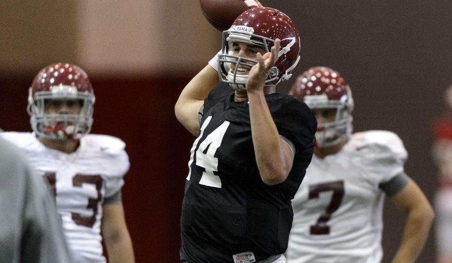 Alabama quarterback Jacob Coker (14) throws during Alabama football practice, Tuesday, Aug. 26, 2014, at the Hank Crisp Indoor Facility in Tuscaloosa, Ala.   (AP Photo/AL.com, Vasha Hunt) MAGS OUT