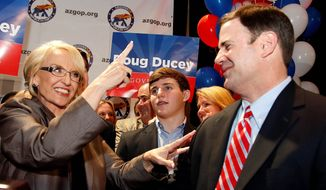 State treasurer and former CEO Doug Ducey (right) bested Arizona Gov. Jan Brewer's Republican candidate for governor, former Mesa Mayor Scott Smith in Tuesday's primary. Mr. Deucy will faceoff against Democrat Fred DuVal in November. (Associated Press)