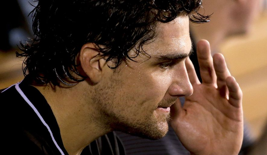 Miami Marlins starting pitcher Nathan Eovaldi reacts in the dugout after being taken out during the fourth inning of a baseball game against the Los Angeles Angels in Anaheim, Calif., Tuesday, Aug. 26, 2014. (AP Photo/Chris Carlson)