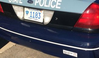 """Chris Kantos posted this photo to Twitter of a Massachusetts State Police cruiser with a bumper sticker reading, """"Racial profiling saves lives."""""""