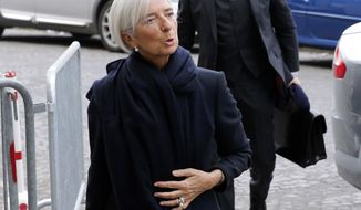"FILE - In this March 19, 2014 file photo, International Monetary Fund chief Christine Lagarde arrives at a courthouse, in Paris, Wednesday, March 19, 2014. Lagarde says she is under official investigation for negligence in a French corruption probe that dates back to her days as finance minister. In a statement released Wednesday, Aug.27, 2014 after a fourth round of questioning before magistrates, Lagarde said she was returning to her work in Washington later in the day and said the decision was ""without basis."" She and her former chief of staff face questions about their role in a 400 million-euro ($531 million) payment to a businessman. (AP Photo/Christophe Ena, File)"