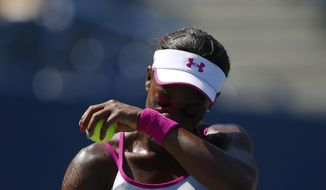 Sloane Stephens, of the United States, wipes sweat from her face between points against Johanna Larsson, of Sweden, during the second round of the 2014 U.S. Open tennis tournament, Wednesday, Aug. 27, 2014, in New York. (AP Photo/Matt Rourke)