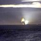 The horizon from Cape Greville in Chiniak, Alaska, lights up after the Advanced Hypersonic Weapon exploded during a test flight Monday, Aug. 25, 2014. (Associated Press via Scott Wight)