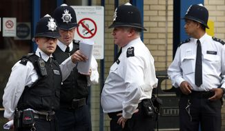 **FILE** British police officers (Associated Press)
