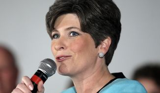 """ADVANCE FOR SATURDAY, AUG. 30, AND THEREAFTER - FILE - This June 3, 2014, file photo shows Iowa Republican Senate candidate Joni Ernst speaking in Des Moines, Iowa. The first midterm elections since both parties embraced a historic change in campaign finance, and with it a sea of campaign cash, will mean for most voters an avalanche of television ads trying to reach the few able to be swayed and willing to vote. In the nation's closest races for U.S. Senate, that translates into """"price per vote"""" that could easily double what was spent in the 2012 presidential election.  (AP Photo/Charlie Neibergall, File)"""