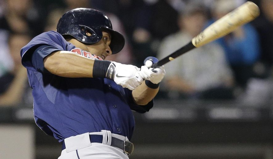 Cleveland Indians' Michael Brantley hits an one-run single against the Chicago White Sox during the seventh inning of a baseball game in Chicago, Thursday, Aug. 28, 2014. (AP Photo/Nam Y. Huh)