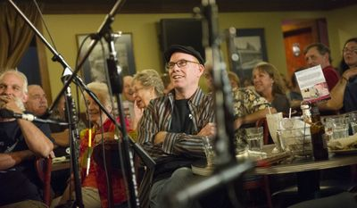 Jim Clark, of Vienna, Va., listens to the music during The Folk Club of Reston and Herndon concert and open mic night event at the Amphora Diner Deluxe in Herndon, Va., Wednesday, August 27, 2014.  (Photo Rod Lamkey Jr.)